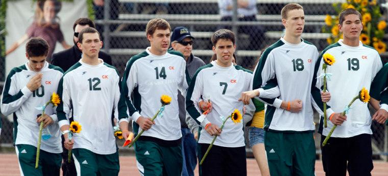 Image: Poway High School soccer team at memorial for Chelsea King