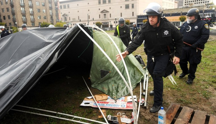 Image: Police officers clear an Occupy Oakland camp