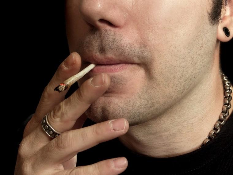 Image: Young man smoking marijuana