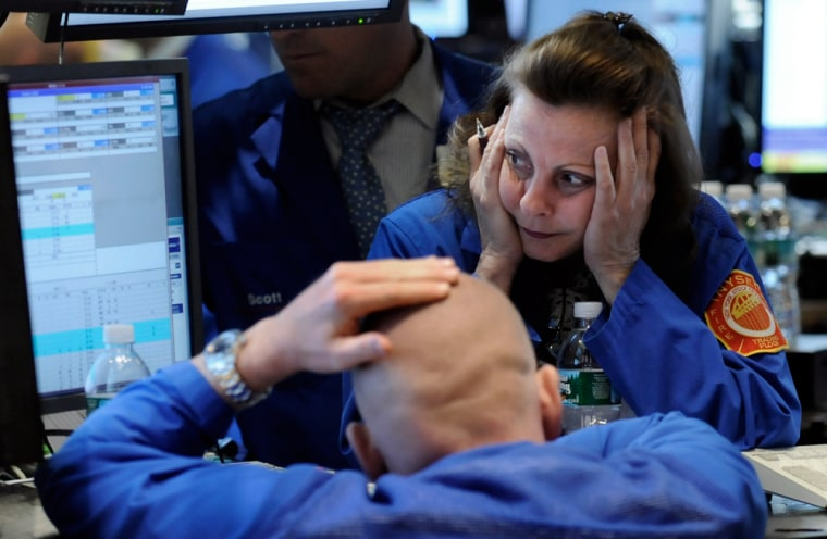 Image: Specialists work at a post on the floor of the New York Stock Exchange