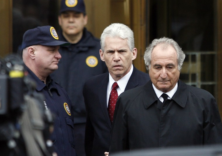 Image: Accused swindler Bernard Madoff exits the Manhattan federal courthouse