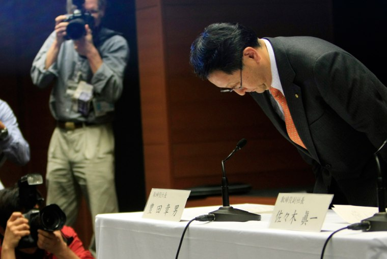 Image: Toyota Motor Corp President Akio Toyoda bows at the start of a news conference in Nagoya, central Japan