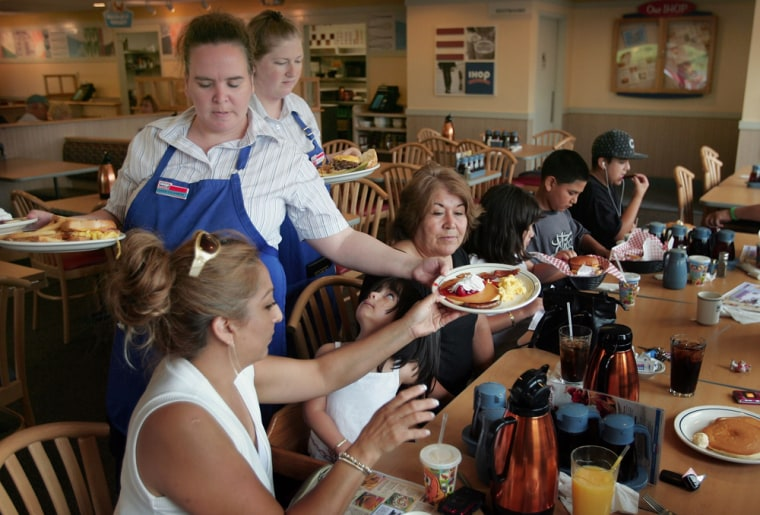 Image: Waitresses Gretchen Boren and Michelle Enright wait on customers at an IHOP restaurant.