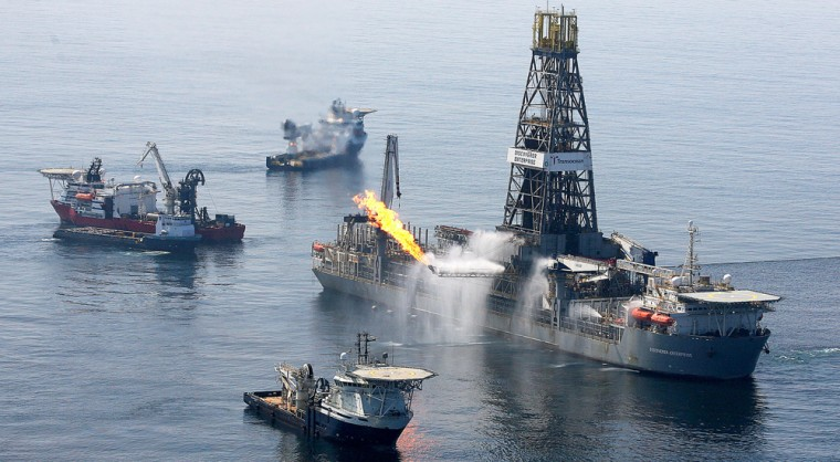 Image: Flames come off the side of the Discoverer Enterprise Drill Ship in the Gulf of Mexico off the Louisiana