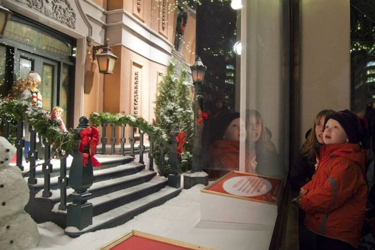 Image: Clodagh O'Sullivan and her son Jack, 2, both of Queens, New York, share the magic that is the holiday season, taking in a display at Lord & Taylor, on Fifth Avenue.