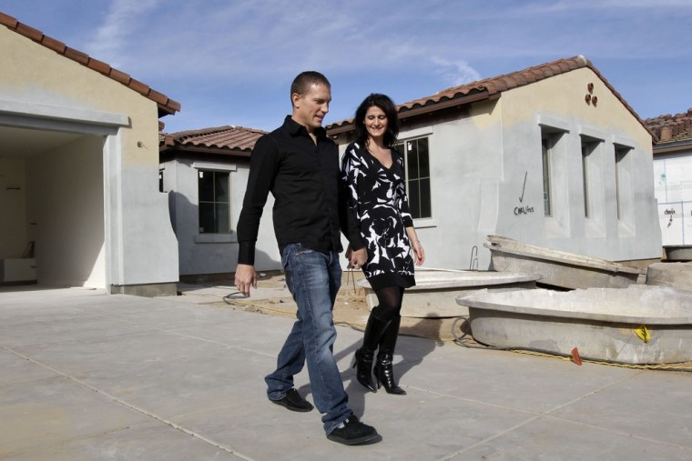 Image: Katie and Mike Zwanziger leave their new home after checking on its progress in Gilbert, Ariz.