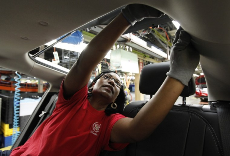Image: Julaynne Trusel works on a Chevrolet assembly line