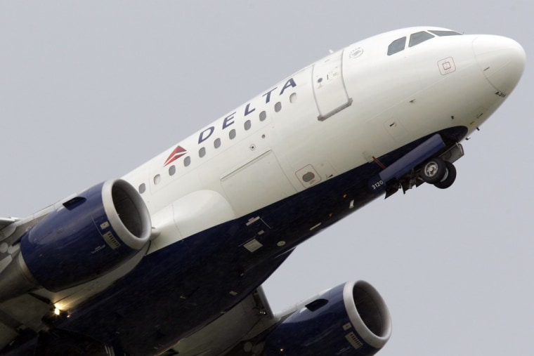 Image: a Delta airlines jet takes off at the Detroit Metropolitan Airport