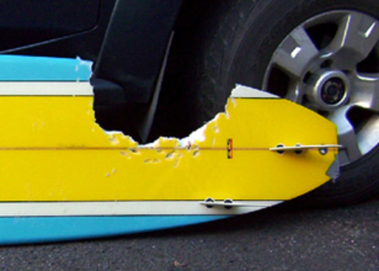 Image: A surfboard which had a chunk taken out of it by a five-metre-long great white shark