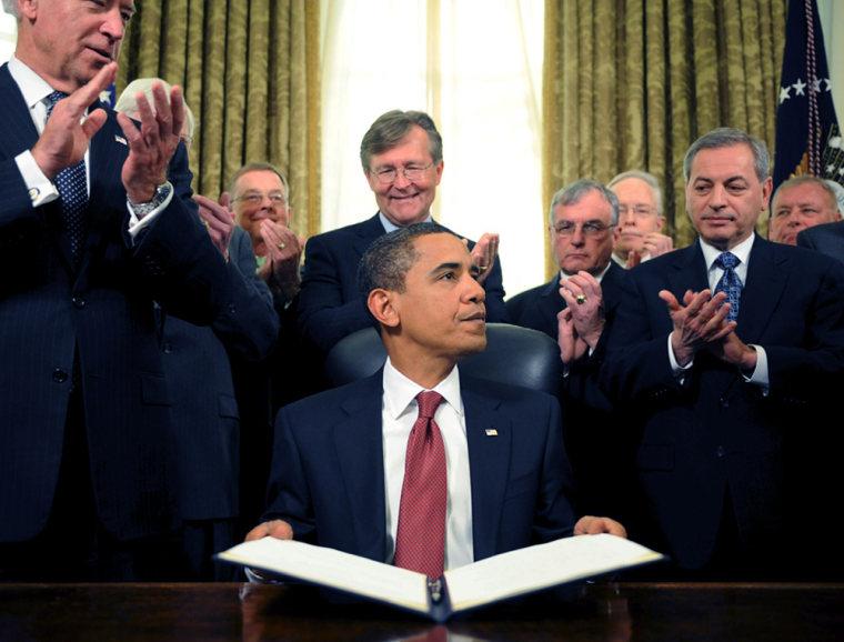 U.S. President Barack Obama signs orders to close Guantanamo Bay