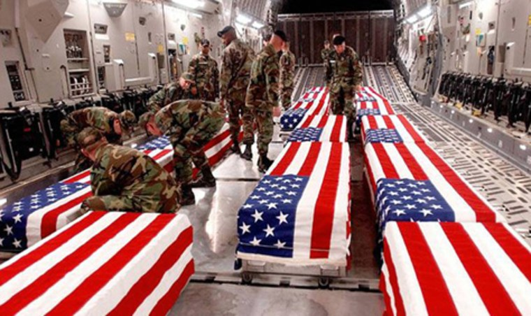 Image: US military personnel offloading coffinsof US soldiers killed in Iraq at DoverAir Base in Delaware