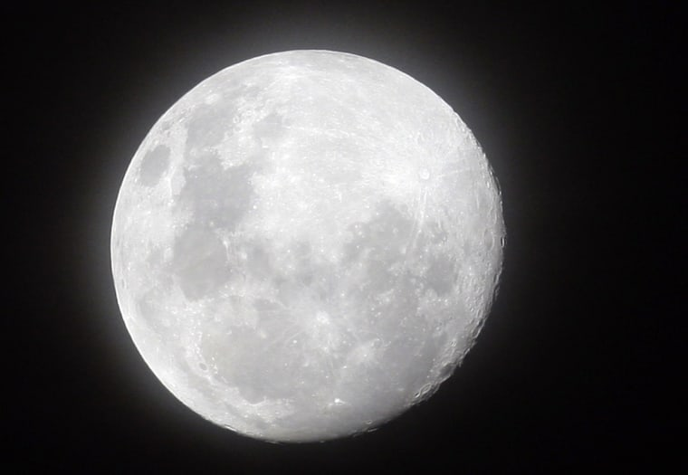 Image: A full moon is seen from Ombaka Stadium in Benguela