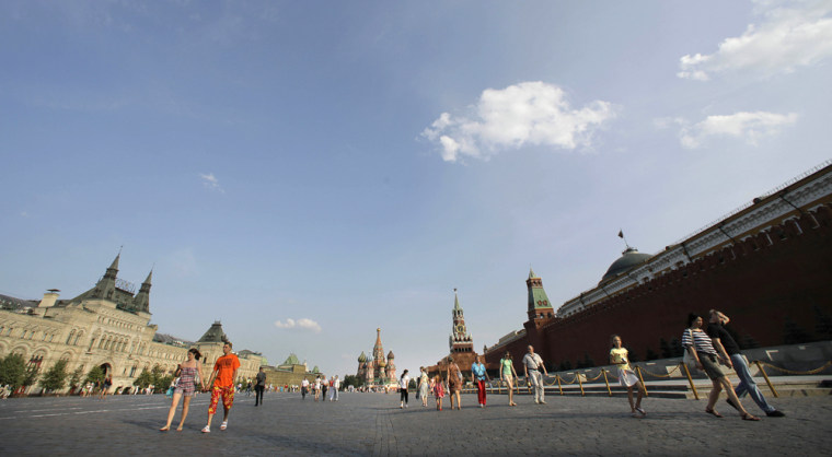 Image: People walk in Moscow's Red Square