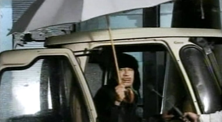 Libyan leader Moammar Gadhafi appears on state televisionearly Tuesday to say he is in Tripoli, not Venezuela, asprotestscalling for his ouster continue.