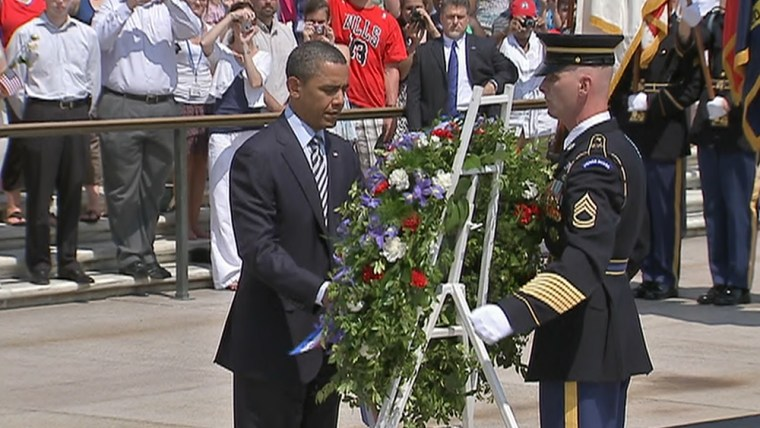 President Barack Obama participates in a wreath-laying ceremony at the Tomb of the Unknowns at Arlington National Cemetery.