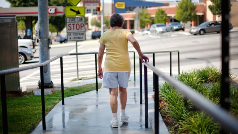 Image: A resident of the Marion Apartments, makes use of a newly constructed ramp