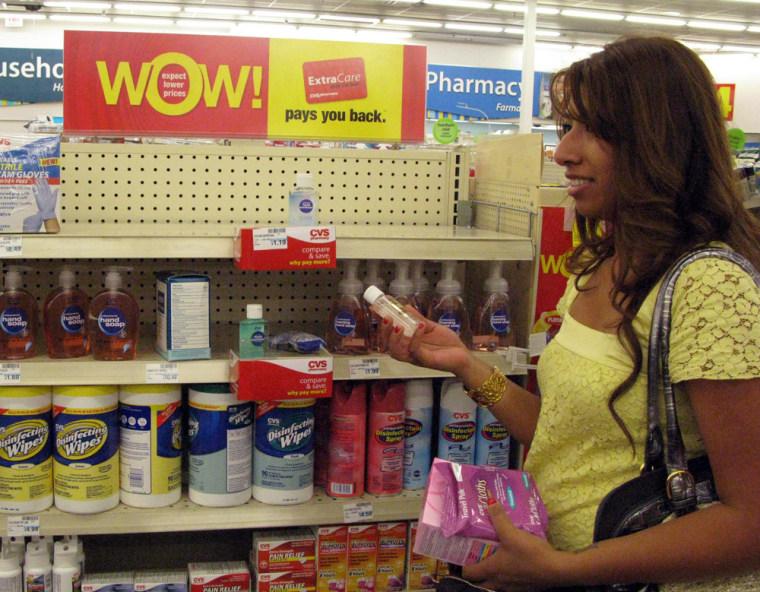 Image: Woman buying hand sanitizer