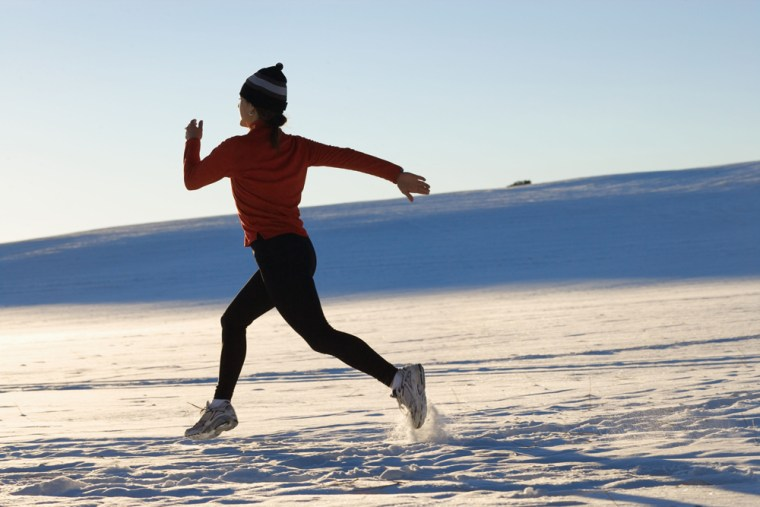 Image: woman running in snow