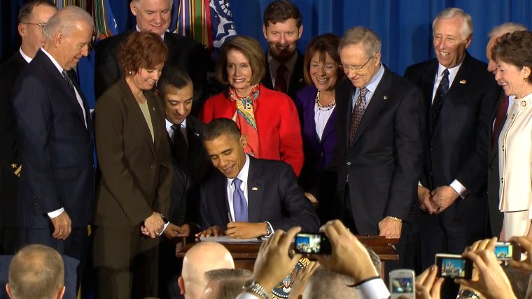 """President Obama signs into law the repeal of """"don't ask, don't tell"""" in Washington on Wednesday."""