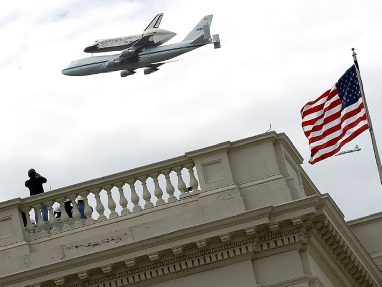 Image: Space Shuttle Discovery flies over the U.S. Capitol