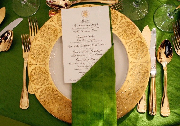 Image: An example of a place setting is seen on display at a State Dinner preview event at the White House in Washington