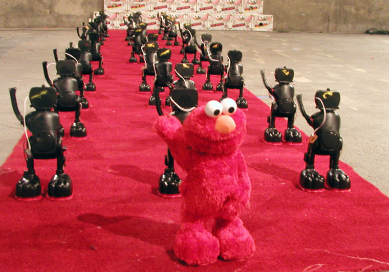 """Well, here's an interesting use for """"Tickle Me Elmo:"""" depicting Napoleon's misguided march into the Egyptian desert. It's part of Eyebeam art and technology center's annual Holiday Hackshop, which lets folks unleash their DIY spirit— in the name of art and environmentalilsm."""