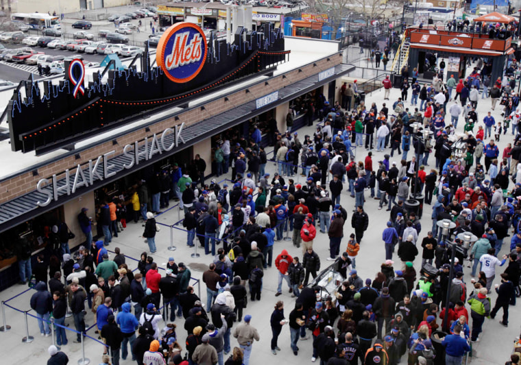 People wait in line at the Shake Shack at Citi Field before the New York Mets and Boston Red Sox exhibition baseball game in New York earlier this month.