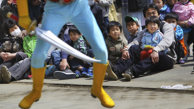 """Image: Children watch their hero """"Sea Jetter Kaito"""" in action at a Children's Day event"""