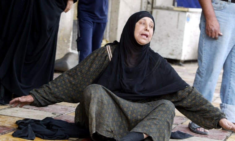 Image: Iraqi woman weeps at the site of a suicide attack