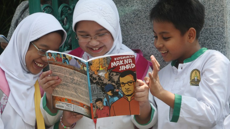 Image: Students read a comic book with an anti-extremist theme at a primary school in Jakarta, Indonesia.