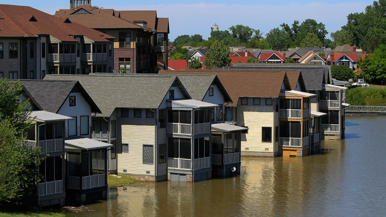 Image: Homes on Mud Island that are usually high above the water level are met by the rising waters of the Mississippi River in Memphis, Tenn.
