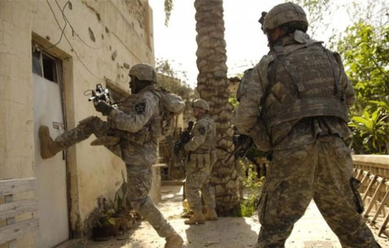 Soldiers conduct a cordon and search in Buhriz, Iraq.