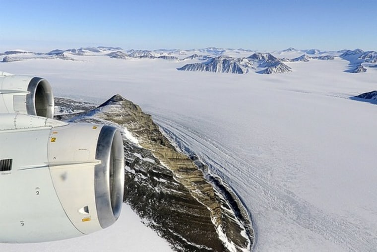 A NASA research aircraft flies over Alexander Island and a connected plain of ice, the George VI ice shelf, where the moving lakes were found.