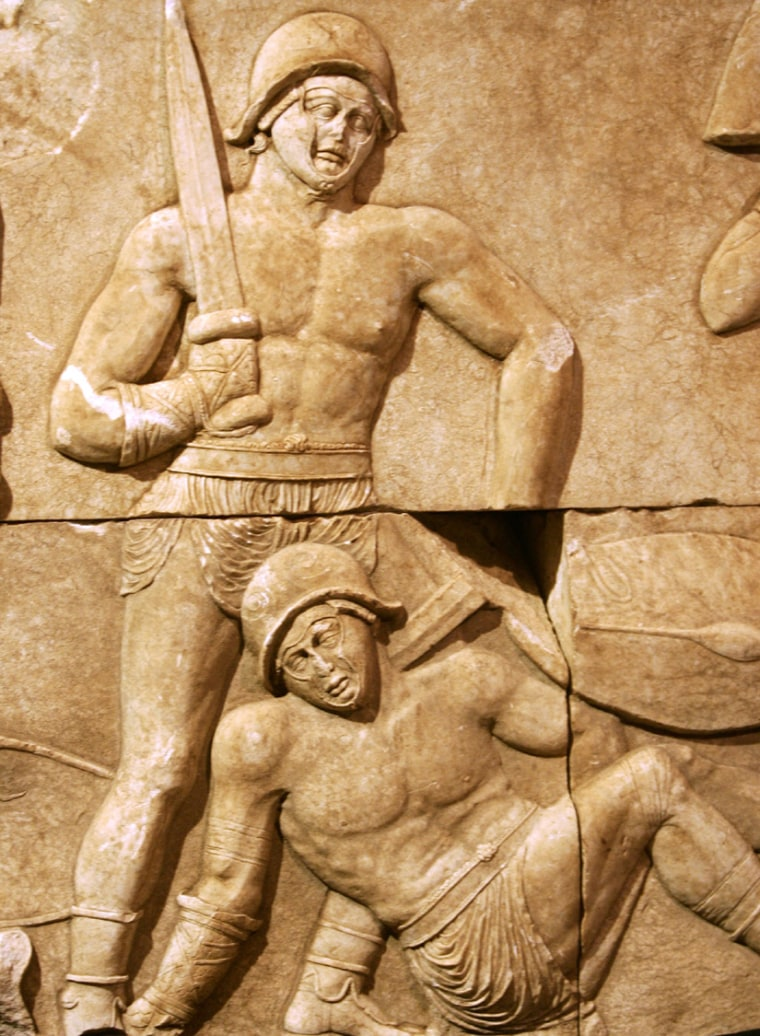 A detail of ancient Roman marble reliefs depicting gladiators in combat. Scientists have analyzed 1,800-year-old skeletons found in York that are believed to have been slain gladiators.
