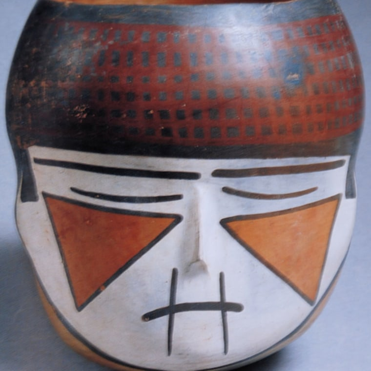 Rossella Lorenzi |   Trophy Head Art The Nasca legacy is linked to the taking of sacrificial heads. This terracotta recovered from a Nazca site represents the culture's favorite theme of severed heads in a modern stylized way