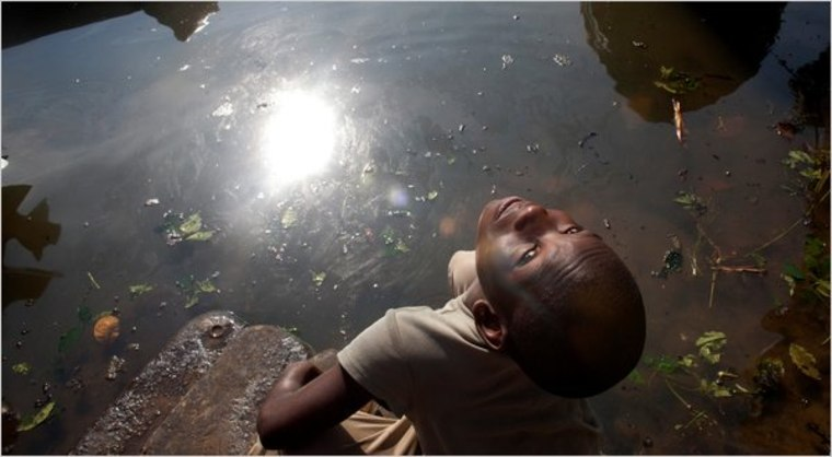 A boy playing by Bodo Creek in Bodo, Nigeria. As many as 546 million gallons of oil spilled into the Niger Delta over the last five decades, experts said.