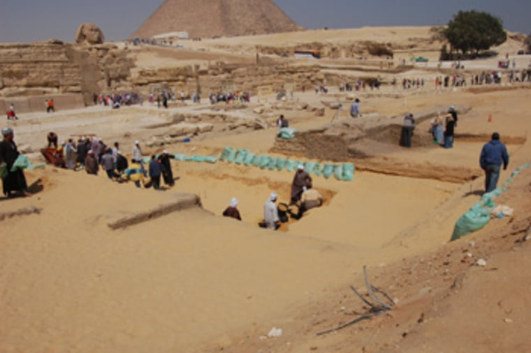 Workers gather at an excavation trench outside Khafre's valley temple at Giza.