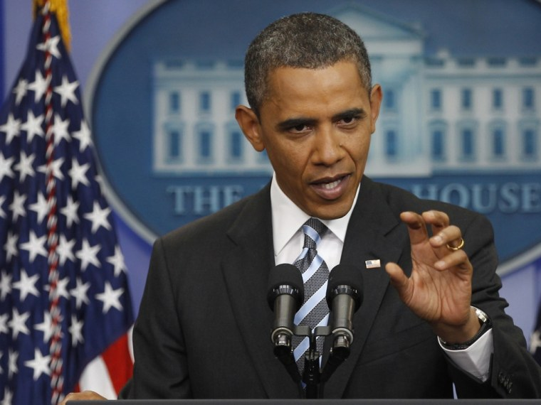 Image: US President Obama answers questions during a news conference in the Brady Press Briefing Room of the White House in Washington