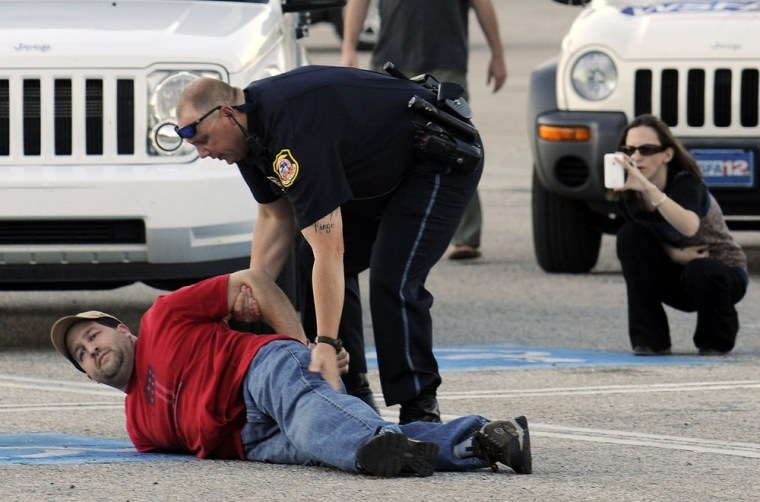 Image: Opelika police take a suspect into custody at Southern Union Community College on Wednesday, April 6, 2011, in Opelika, Ala.