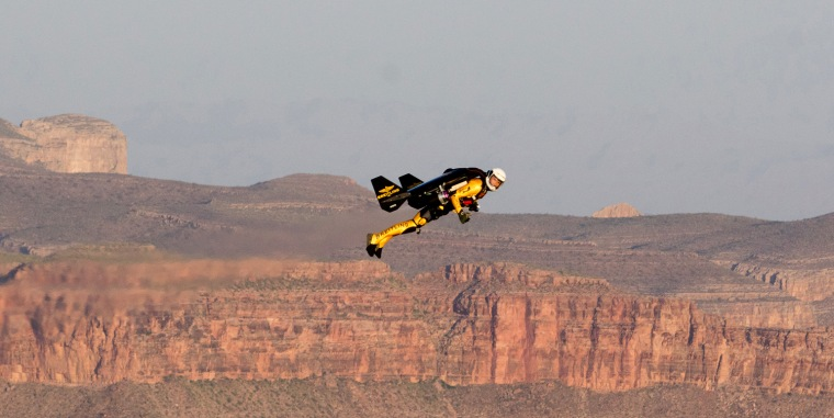 Yves Rossy's sponsor, Breitling, released this image Tuesday, saying it shows him shortly after jumping out of a helicopter and flying 200 feet above the rim of the Grand Canyon West on Saturday.