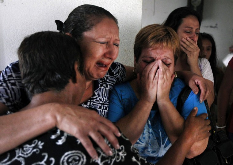 Image: Relatives and friends of Leal react after being notified of his execution in Guadalupe