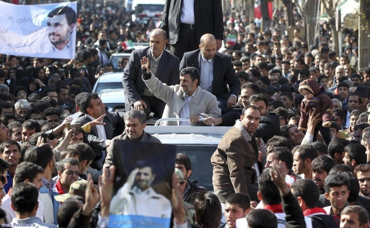 Image: Iranian President Mahmoud Ahmadinejad waves to supporters while visiting the city of Shahrekord in Chahar Mahal and Bakhtiari province