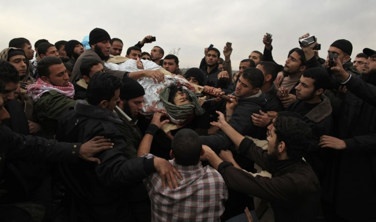 Image: Palestinians carry the body of militant Abu Daf during his funeral in Gaza