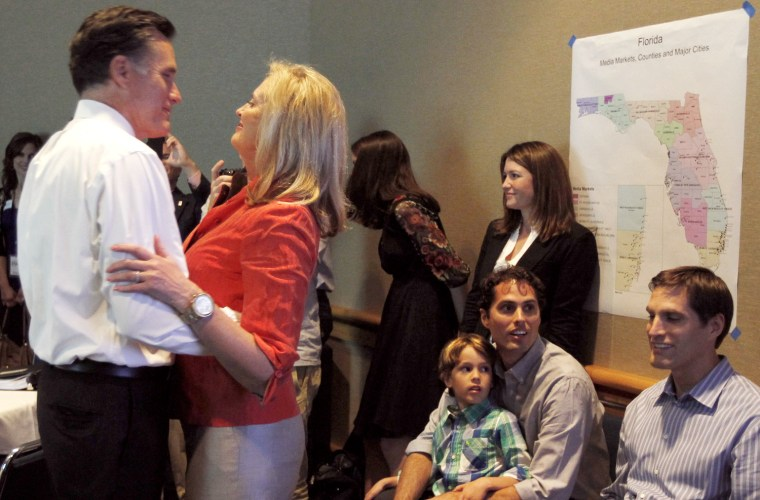 Image: Republican presidential candidate and former Massachusetts Governor Mitt Romney hugs his wife Ann as they hear him declared the winner of the Florida primary by television networks in Tampa