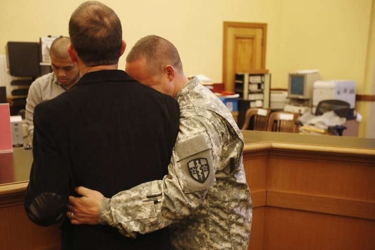Image: U.S. Army Captain Michael Potoczniak and partner Todd Saunders obtain their marriage license at City Hall in San Francisco