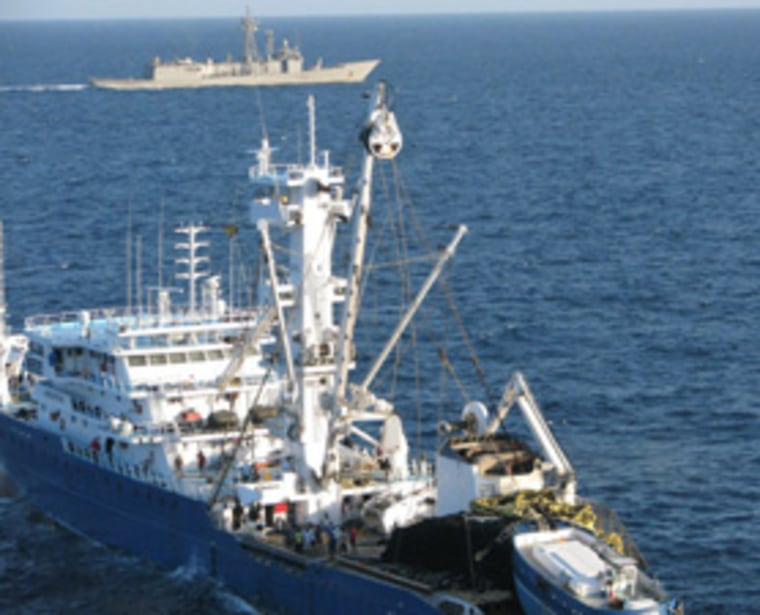 A warship escorts the 'Alakrana' on Nov. 17, 2009 after the fishing vessel been held for 47 days by Somali pirates. A new system being tested on the space station could help curb such incidents.