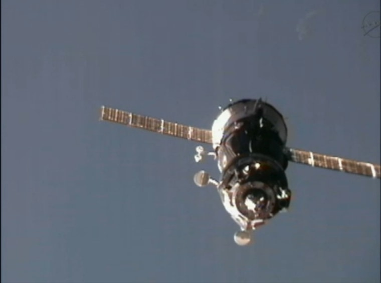The Russian Soyuz TMA-03M pulls up to the International Space Station on Thursday, carrying three new crew members for the station's Expedition 30 mission.