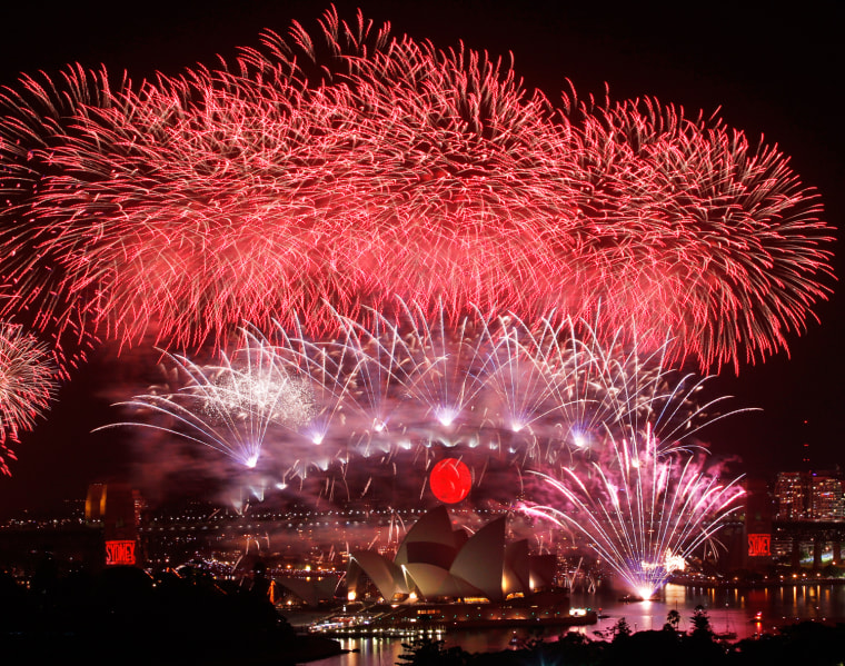 Image: Fireworks explode over the Sydney Harbour Bridge and Opera House during a pyrotechnic show to celebrate the New Year