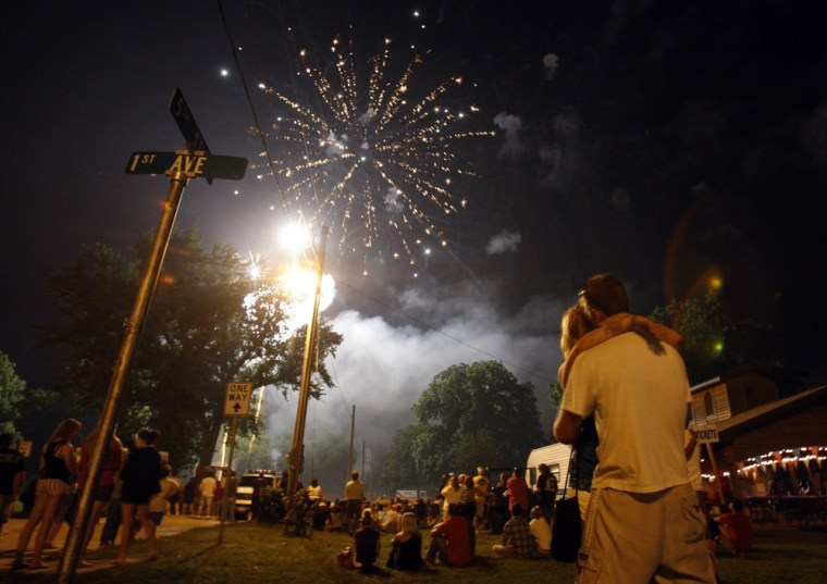 Image: A couple kiss during the Independence Day fireworks display in Independence