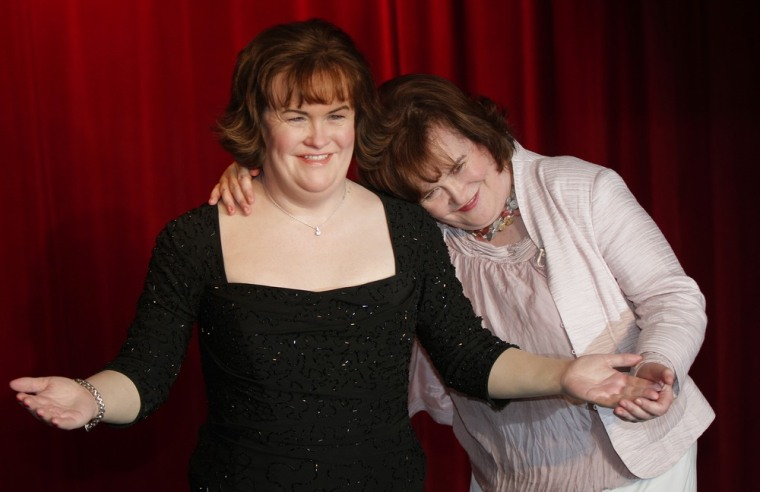 Image: Scottish singer Susan Boyle stands with her new wax work model at Madame Tussauds in Blackpool, northern England